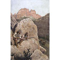 Apaches vigilando desde las rocas