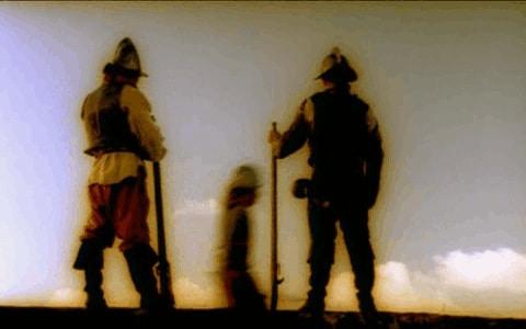 Soldados españoles con un prisionero