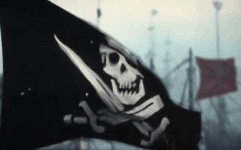 Bandera negra pirata con calavera y espadas